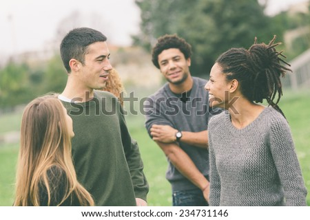 Multiethnic Group of Friends at Park - stock photo