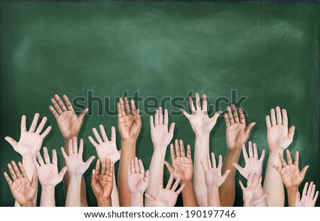 Multiethnic Group of Hands Raised with Blackboard  - stock photo