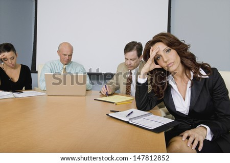 Multiethnic group of serious businesspeople at a meeting - stock photo
