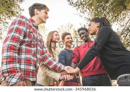 Multiethnic Group of Teenagers, Teamwork Concept  - stock photo