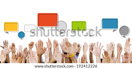Multiethnic Hands Raised with Speech Bubbles - stock photo
