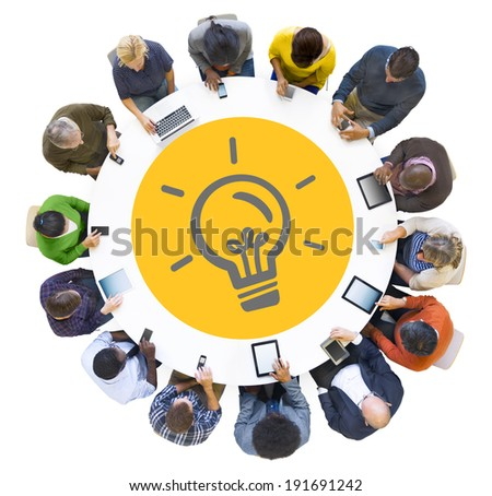 Multiethnic People Using Digital Devices with Light Bulb Symbol - stock photo