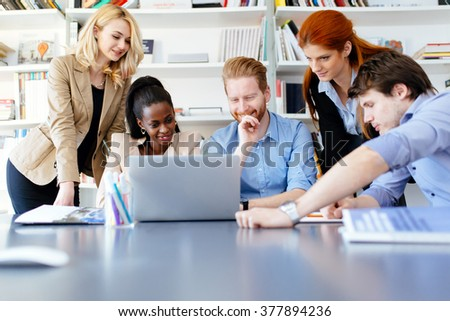 Multiethnic people working in modern well equipped office - stock photo