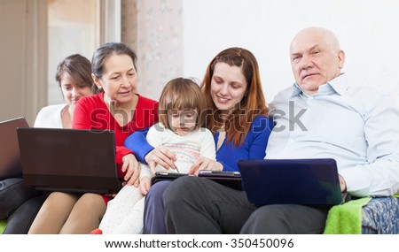 multigeneration family  together with few electronic communication devices