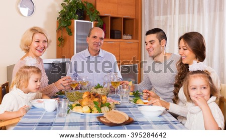 Multigenerational european family having dinner at home