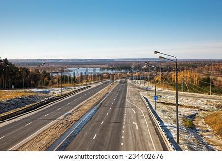 multilane paved road  landscape in autumn - stock photo