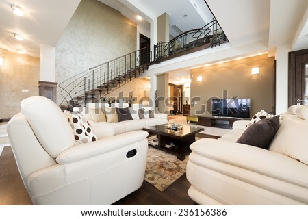 Multilevel luxury furnished apartment interior - stock photo