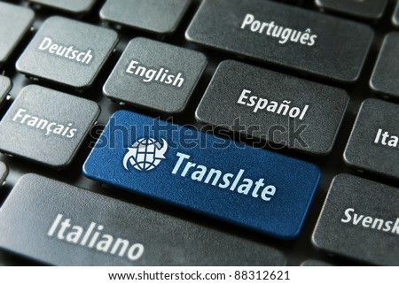 Multilingual translation on-line concept. Close up of multi language keyboard and translate word key in blue color with clipping path. - stock photo