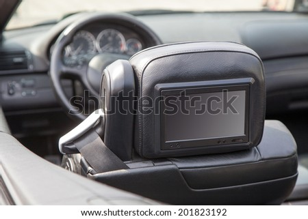 Multimedia backseat screen in a luxury car - stock photo
