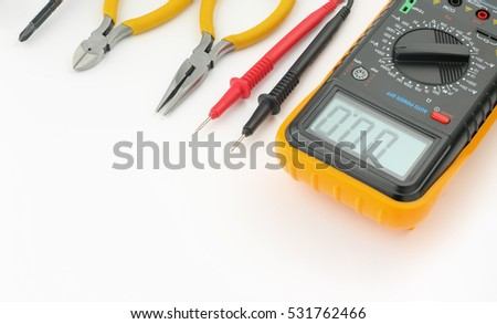 Multimeter, probes, needle nose pliers, wire cutters, screwdriver on  white background