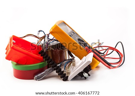 Multimeter, switch, insulation tape, electrical transformers tester on a white background - stock photo