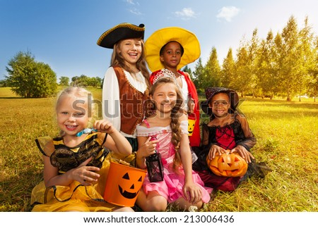 Multinational children in Halloween costumes - stock photo