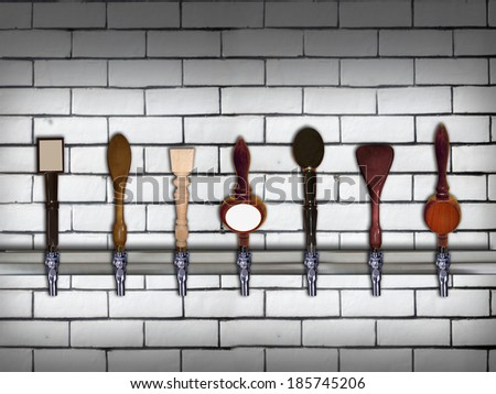 Multiple beer taps in a row - stock photo
