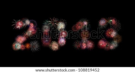 Multiple bursts of colorful fireworks were used to write out the new year 2013 against a black background