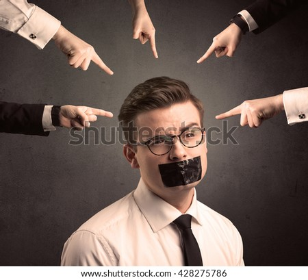 Multiple caucasian hands pointing at business male employee - stock photo