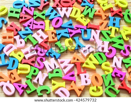 Multiple colored wooden letters - stock photo