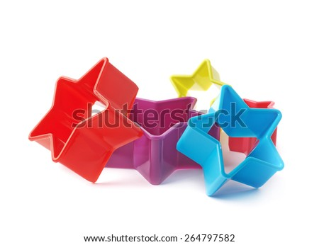 Multiple colorful star shaped set of baking molds, composition isolated over the white background - stock photo