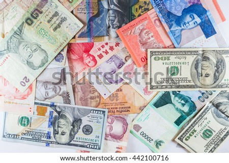 Multiple currency banknotes as colorful background showed the global money financial business economy crisis due to British out of European Union - stock photo