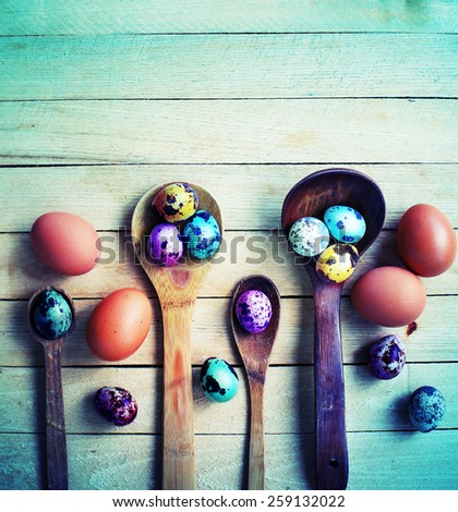 Multiple Easter egg decorations  over  wooden surface as a festive background composition - stock photo