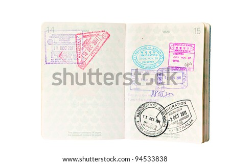 Multiple entries into South East Asia and Australia, resulting in many entry and exit stamps in a Canadian passport. Isolated on white. - stock photo