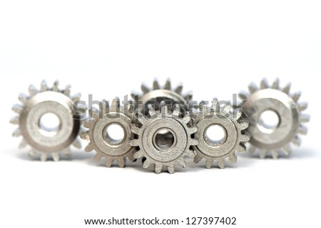 Multiple gears row on white background - stock photo