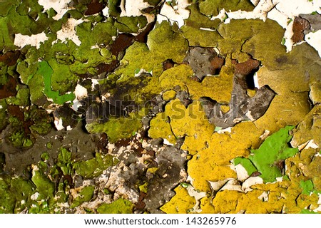 Multiple layers of paint peeling off the wall - stock photo