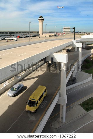 Multiple levels and modes of transport at a modern airport - stock photo