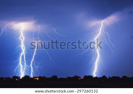 Multiple lightning strike at night - stock photo