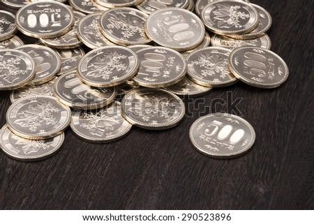 Multiple of five hundred yen coin - stock photo