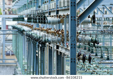 Multiple Power Lines at a Power Generation Plant - stock photo