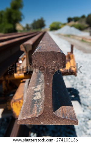 Multiple rails wait for installation on a train track - stock photo