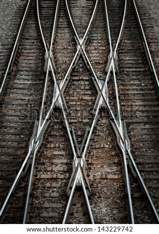 Multiple railway track switches , symbolic photo for decision, separation and leadership qualities. Also symbolizes confusion due to many choices. - stock photo