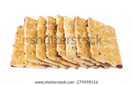 Multiple raisin cracker cookies stacked one over another, composition isolated over the white background - stock photo