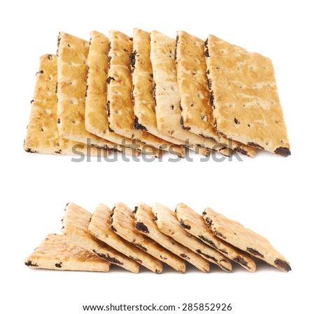 Multiple raisin cracker cookies stacked one over another, composition isolated over the white background, set of two different foreshortenings - stock photo