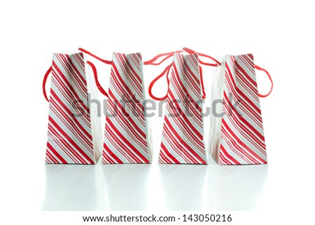 Multiple red stripe shopping bags isolated on white background - stock photo