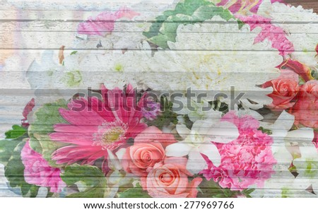 multiple rose flower decoration with wood texture background - stock photo