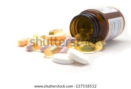 Multiple tablets and a bottle - stock photo
