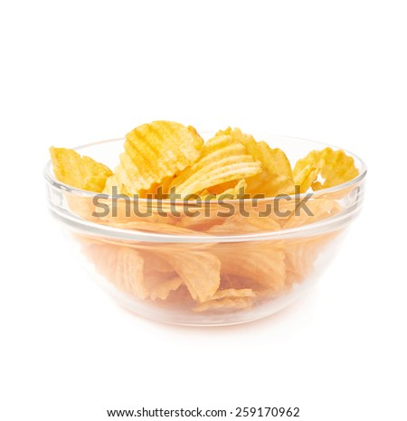 Multiple yellow ribbed wavy potato chips snacks in a glass bowl, composition isolated over the white background - stock photo