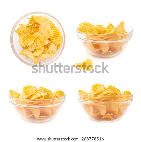 Multiple yellow ribbed wavy potato chips snacks in a glass bowl, composition isolated over the white background, set of four different foreshortenings - stock photo