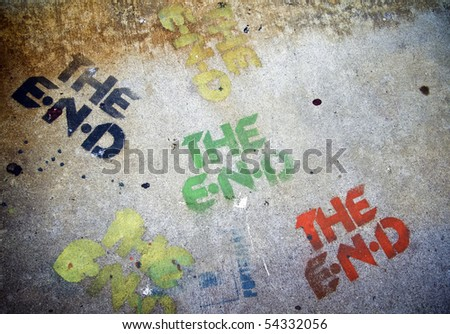 Multiply color The End Sign on the grunge cement pavement.