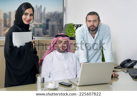 Multiracial Business Meeting in office , arabian businessman & arabian Secretary wearing hijab & a Foreigner meeting in office  - stock photo
