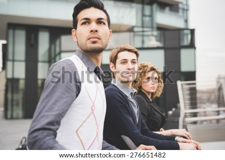 Multiracial business people working outdoor in town connected with technological devices - stock photo