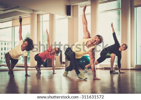 Multiracial group during aerobics class - stock photo