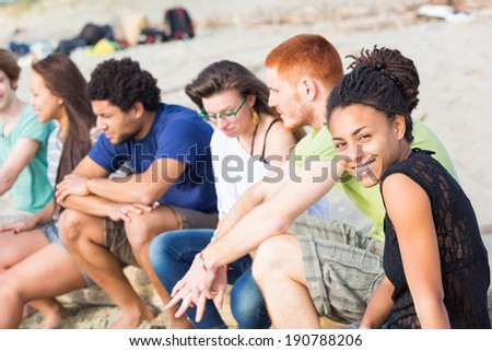 Multiracial Group of Friends at Beach - stock photo