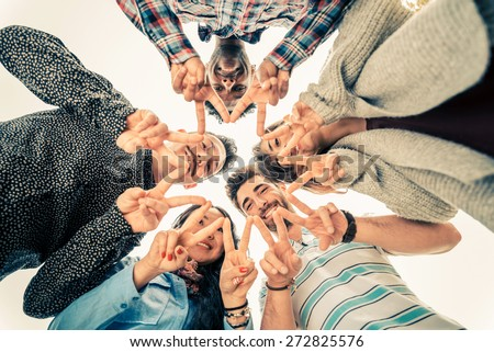 Multiracial group of people in circle making a star shape with hands gesture - Friends looking down with v-shapes finger position - Concepts about friendship,lifestyle,unity,business and teamwork - stock photo