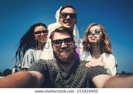 Multiracial group of young hipster friends make selfie photo with smartphone camera while traveling across Asia on summer vacation - stock photo