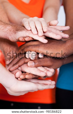 multiracial group people hands together - stock photo