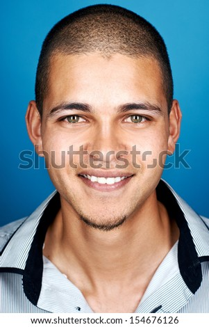 multiracial man portrait smiling happy real person on blue background - stock photo
