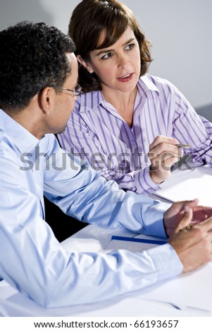 Multiracial office workers in boardroom meeting talking while watching presentation, focus on woman - stock photo
