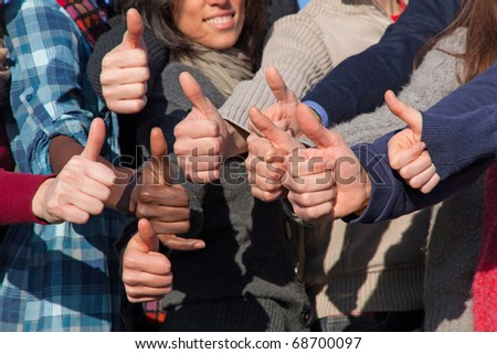 Multiracial Thumbs Up - stock photo
